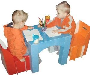 Image: Children's Table and Chair Set -  Set up and put away these lightweight coated cardboard pieces in just minutes